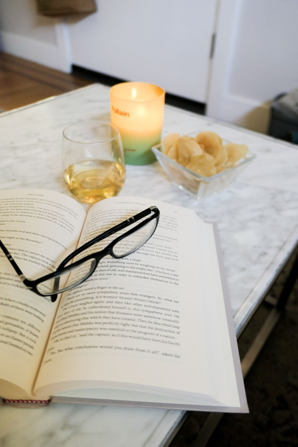 Open Book on Table with Glasses On Top - What to Read this Month - The Boyfriend Project
