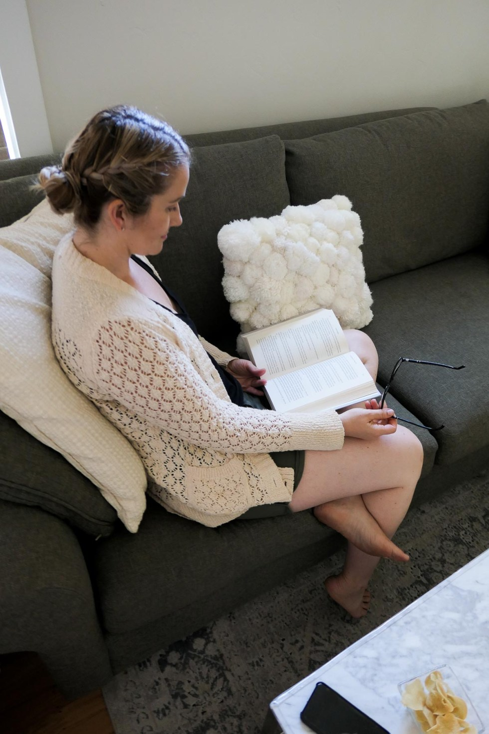 The Boyfriend Project Book to Read Right Now - Woman on Couch with Book