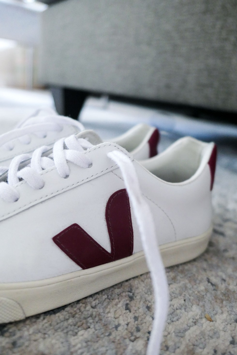 Veja sustainable shoes with distressed blue jeans and white button down shirt