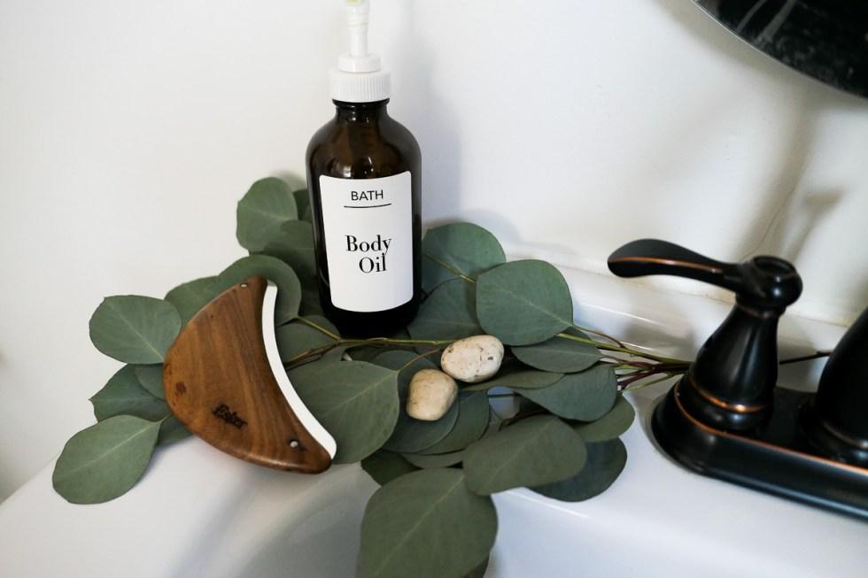 Beauty Body Tools - Body Plane on Green leaves w. Body Oil Bottle