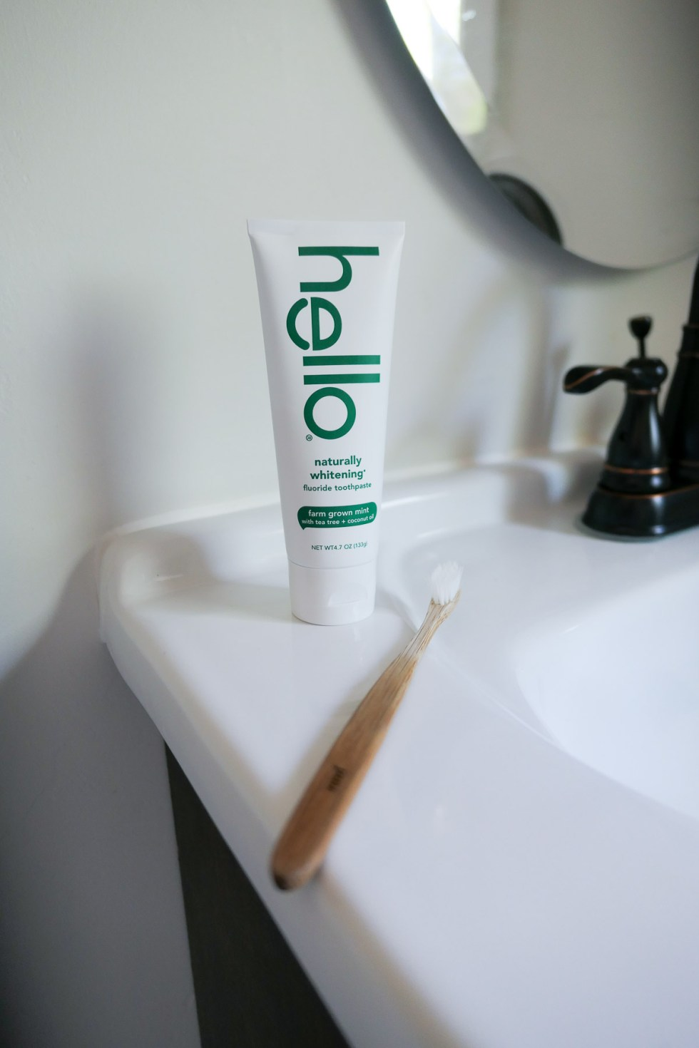 Hello Natural Toothpaste w. Toothbrush on Counter