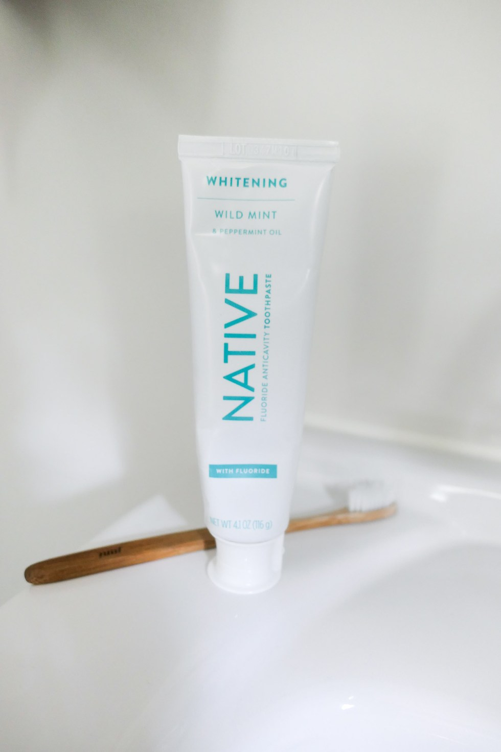 Native Natural Toothpaste w. Toothbrush on Counter