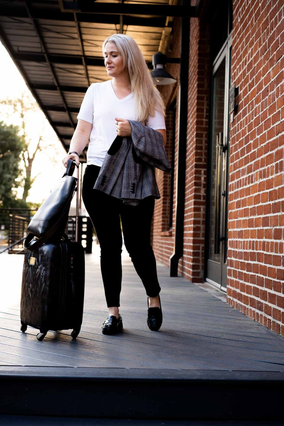 Fall Travel Outfits - White Tee + Jeans with Spinner Suitcase