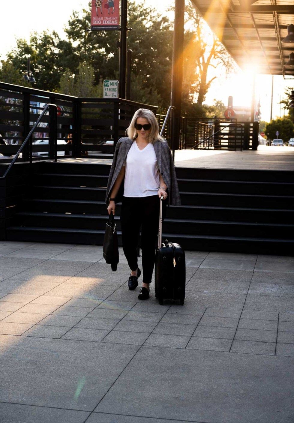 Fall Travel Outfits - White Tee + Jeans - Walking with Spinner Suitcase