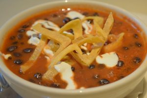 Black Bean Soup drizzled with sour cream