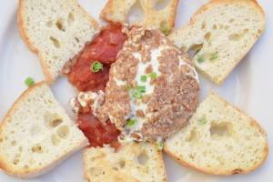 Pecan Crusted Goat Cheese with tomato jam and crostini