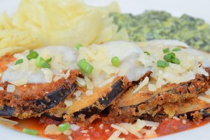 Eggplant Creole topped with melted provolone