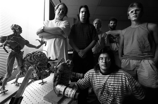 ORG XMIT:  [NZ_16DOOM ]  Headline:    Caption: 8/16/94-Clockwise from top left: Jay Wilbur, business manager, Adrian Carmack, artist/founder, Bobby Prince,  music/sound engineer, Kevin Cloud, artist, John Carmack, lead  programmer/founder and John Romero, game developer/founder of Id Software makers of the highly popular, action-packed 3-D virtual  reality software game called, 'DOOM.' DOOM II is scheduled to be released October 10th. The figures at left are creatures from the  game.   Photographer: Title:    Credit:    City:    State:     Country: Date:    ObjectName: NZ_16DOOM   CaptionWriter: Special:    Category:    SupCat1:    SupCat2: SupCat3:     Source:    Keyword: NZ_16DOOM Keyword: 72878   Keyword: David  Leeson   Keyword: DOOM   Keyword: Id Software   Keyword: John Romero   Keyword: John Carmack   Keyword: Kevin Cloud   Keyword:  Bobby Prince   Keyword: Adrian Carmack   Keyword: Jay Wilbur    Keyword: 8/16/94