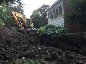 Another view of the moat with the backhoe.