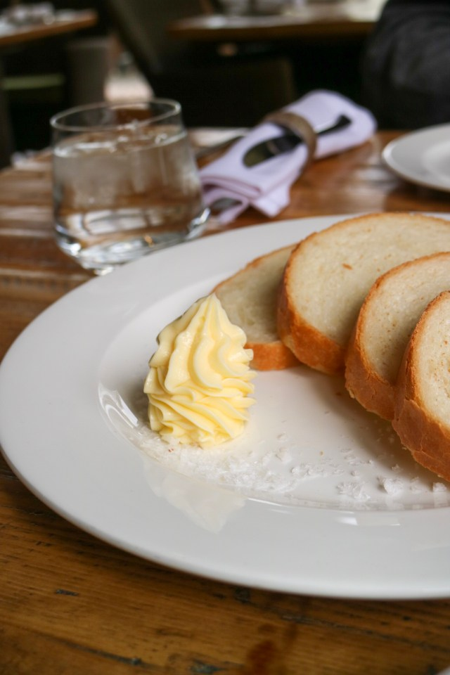 locally made bread with butter and salt flakes in the ye olde bell spa restaurant