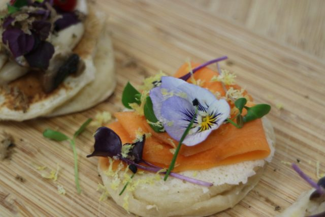 blini with carrot and a flower for decaration