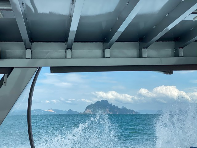 view from the boat with waves splashing up