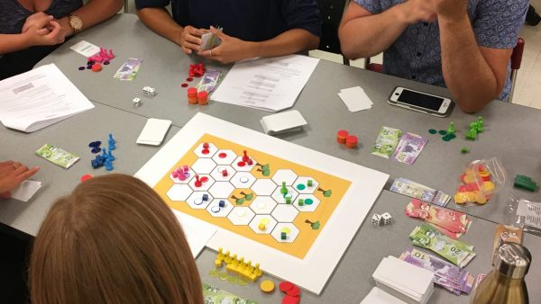 Board games to engage in systems thinking