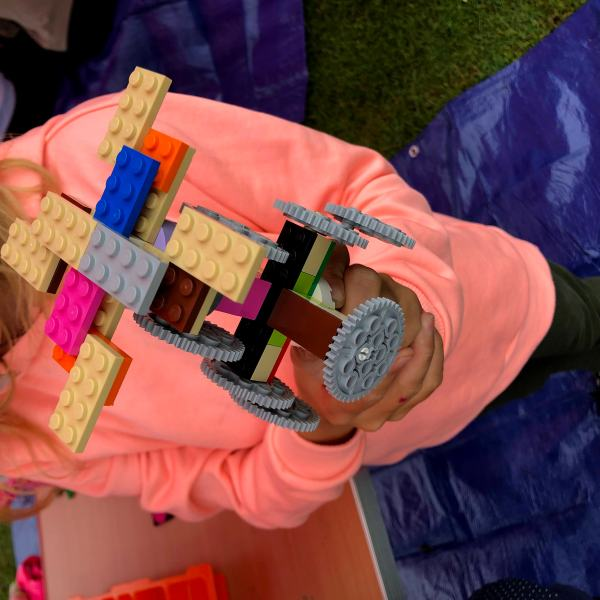Child with lego model