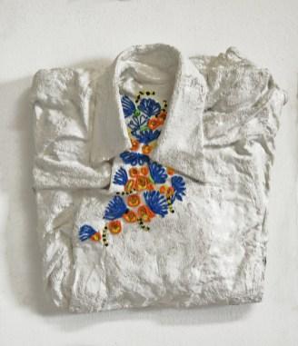 florens10 arch.n. 947 indumento + gesso e resine + colori ad olio, cm 35x36x8, 2010-2012