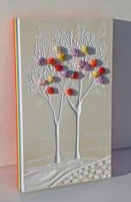 """Mattoncino dai buoni frutti - arch.n. 1873/5 - cm 30x17,5 Smalto e incisione su collage di PVCda riciclo (7 strati da 0,5 cm a creare l'arcobaleno) + i """"frutti"""" sono creati con vestiti usati compattati con filo di acciaio inox e resina. Avvitati dal retro."""