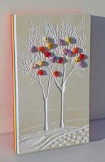 """Mattoncino dai buoni frutti - arch.n. 1873/5 - cm 30x17,5 Smalto e incisione su collage di PVCda riciclo (7 strati da 0,5 cm a creare l'arcobaleno) + i """"frutti"""" sono creati con vestiti usati compattati con filo di acciaio inox e resina. Avvitati dal retro. L'opera è archiviata ed è completa di attaccaglia. € 50"""