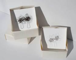 i BUONI-FRUTTI- archivio n. 1950- cm 18x18- 2021. Plexiglass bianco lucido + stoffa resinata e filo acciaio. Scatola in carta, creata con la tecnica dell'origami.