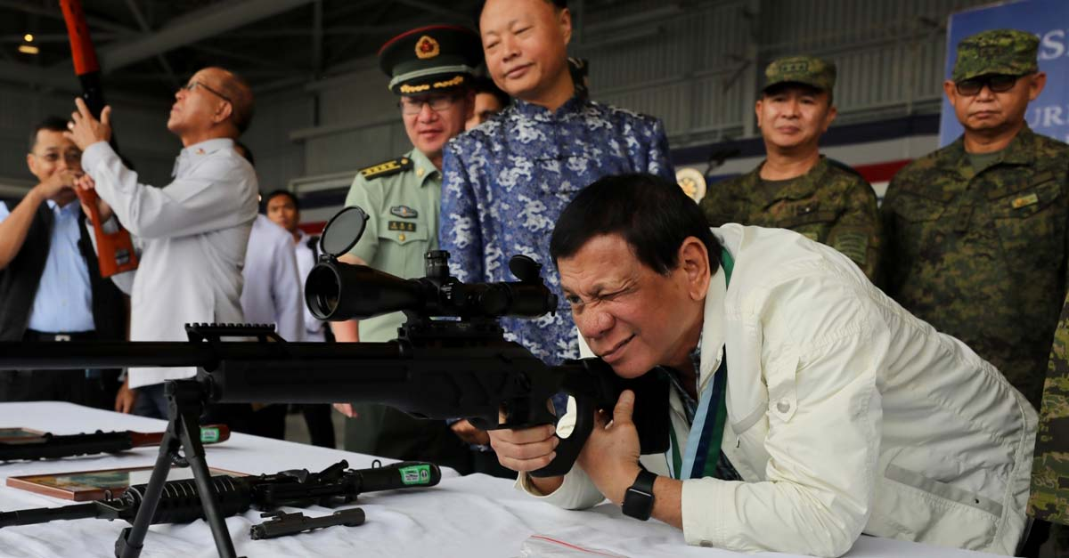 Rodrigo Duterte with rifle