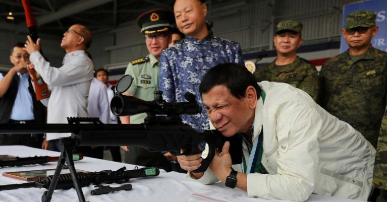 Rodrigo Duterte with rifle