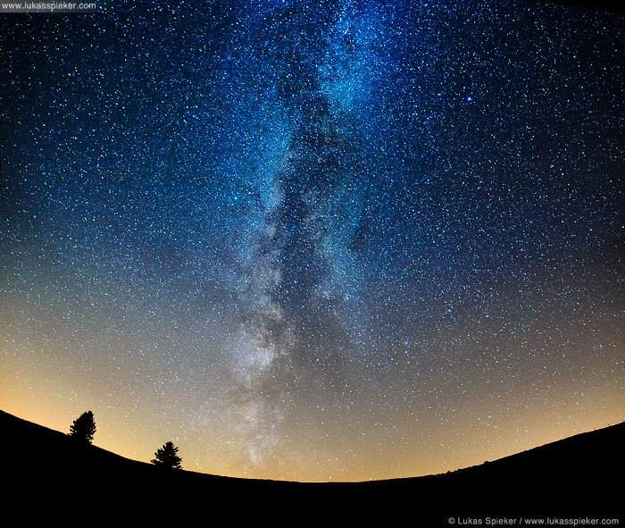 The Milky Way appears as a glowing band arching across the night sky in Switzerland, August 15, 2013. The Milky Way is a spiral galaxy containing 100 to 400 billion stars and planets, among them our solar system. The oldest known star in the Galaxy is at least 13.6 billion years old. The photo consists of four single exposures stitched together for a broad view of the night sky.
