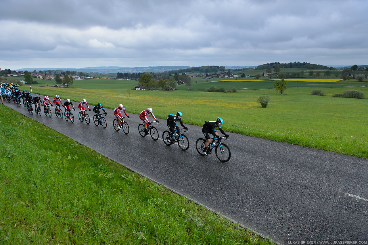 The peloton passes Ependes during the 4th stage of the Tour de Romandie in Switzerland May 3, 2014.