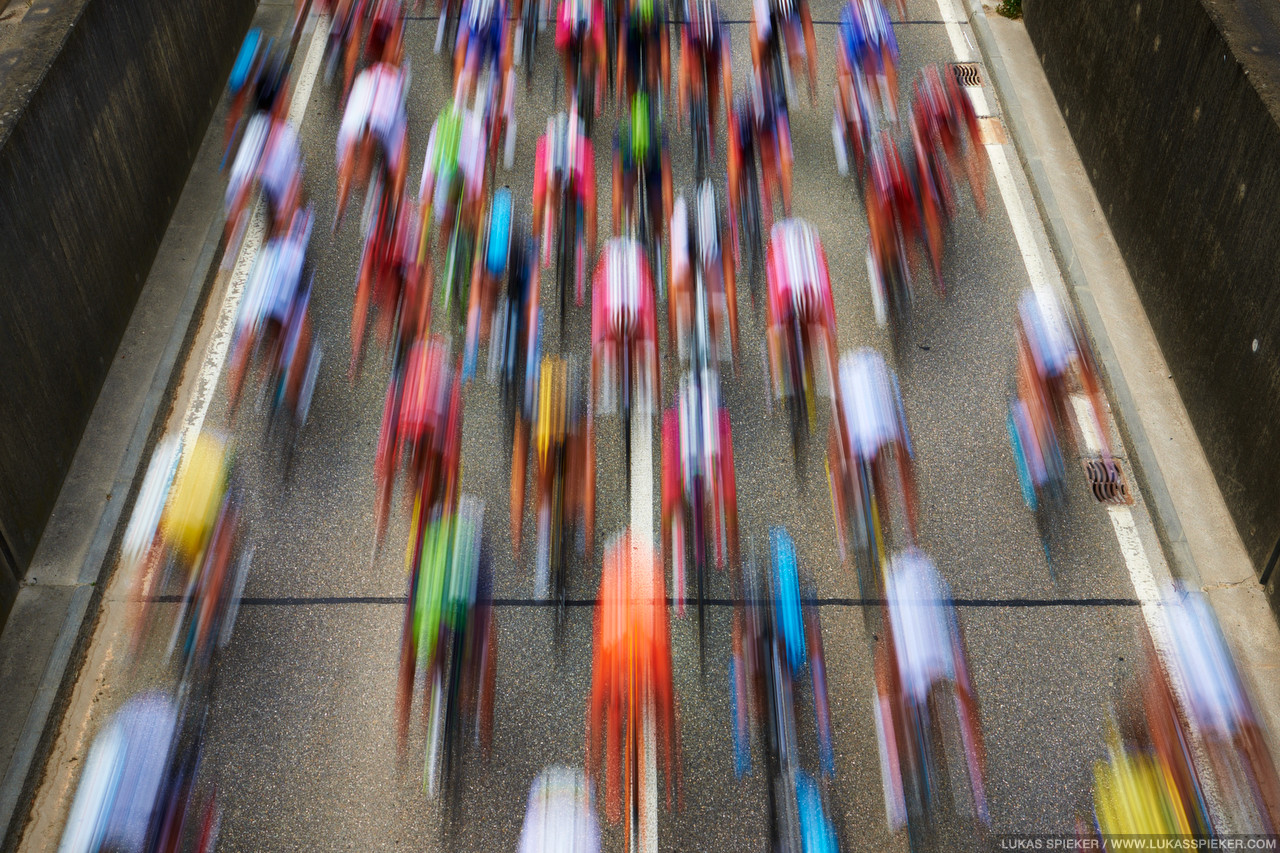 Riders race through the village Arch during the 5th stage of the Tour de Suisse leading from Ossingen to Bueren, Switzerland June 18, 2014.