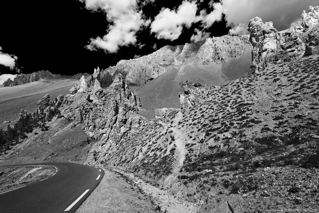 Col d'Izoard is a 2360 m mountain pass in the French Alps. The road on the south side of the pass leads through dramatic rock formations and pinnacles – La Casse Deserte.
