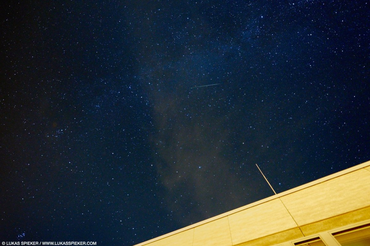 A shooting star races over the night sky  in Switzerland on August 13, 2015. Shooting stars, or meteors, are visible paths of small particles racing into the atmosphere of the earth making the air glow. These meteor showers are called Perseids.