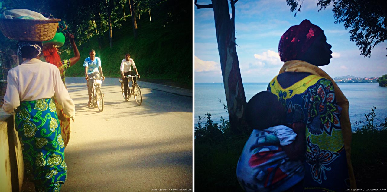 On the road winding through villages, people march in the direction of Gisenyi carrying vegetables for trading at the border. A woman carries her toddler on the back walking towards Gisenyi at Lake Kivu, Rwanda.