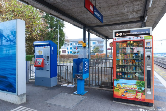 Vending machines for tickets and snacks are standing at the train station in Selzach. Between them is the ubiquitous newspaper distribution box.The first vending machine goes back to the ancient Greeks. There were tobacco vending machines in English taverns in the 17th century. Modern vending machines for postcards, newspapers, or stamps were constructed in the 19th century.