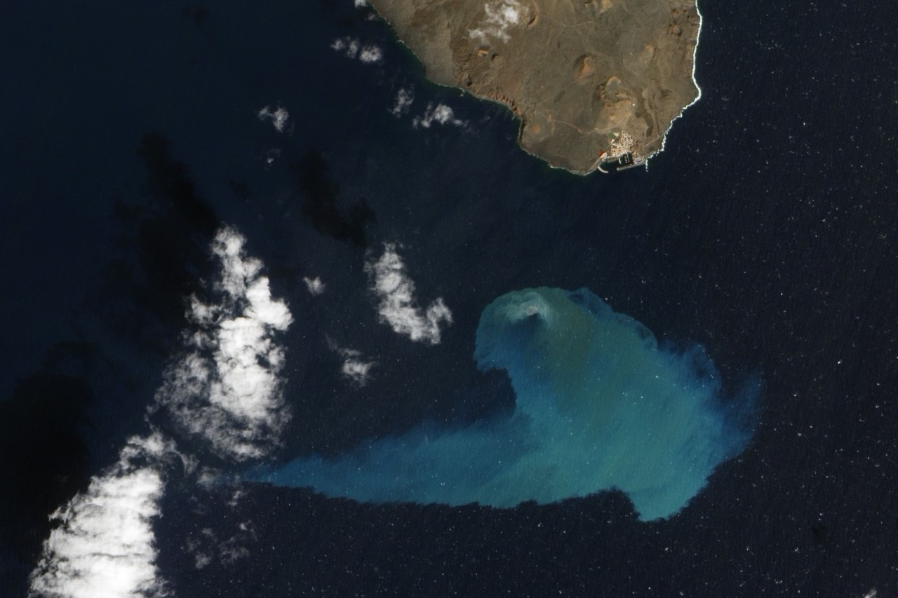 Four months after the underwater volcanic eruption off El Hierro, discoloration of the water indicates volcanic material in this natural-color satellite image taken February 10, 2012. NASA Earth Observatory image used with permission.