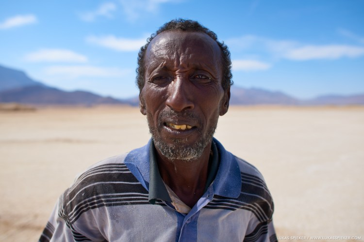 Aras and his family harvest the salt at the shore of Lac Assal in Djibouti. The extraction of salt from Lac Assal has a long tradition among local Afar tribes. The lake in the desert in the north of the Great Rift Valley is based on volcanic basalt, and surrounded by geothermal springs and the Ardoukoba volcano that last erupted in 1978.