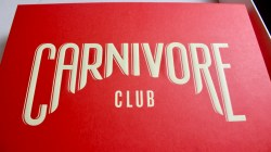 A large red rectangular box with Carnivore written in large white capital letters, and club written in smaller white capital letters on it, on a white background.