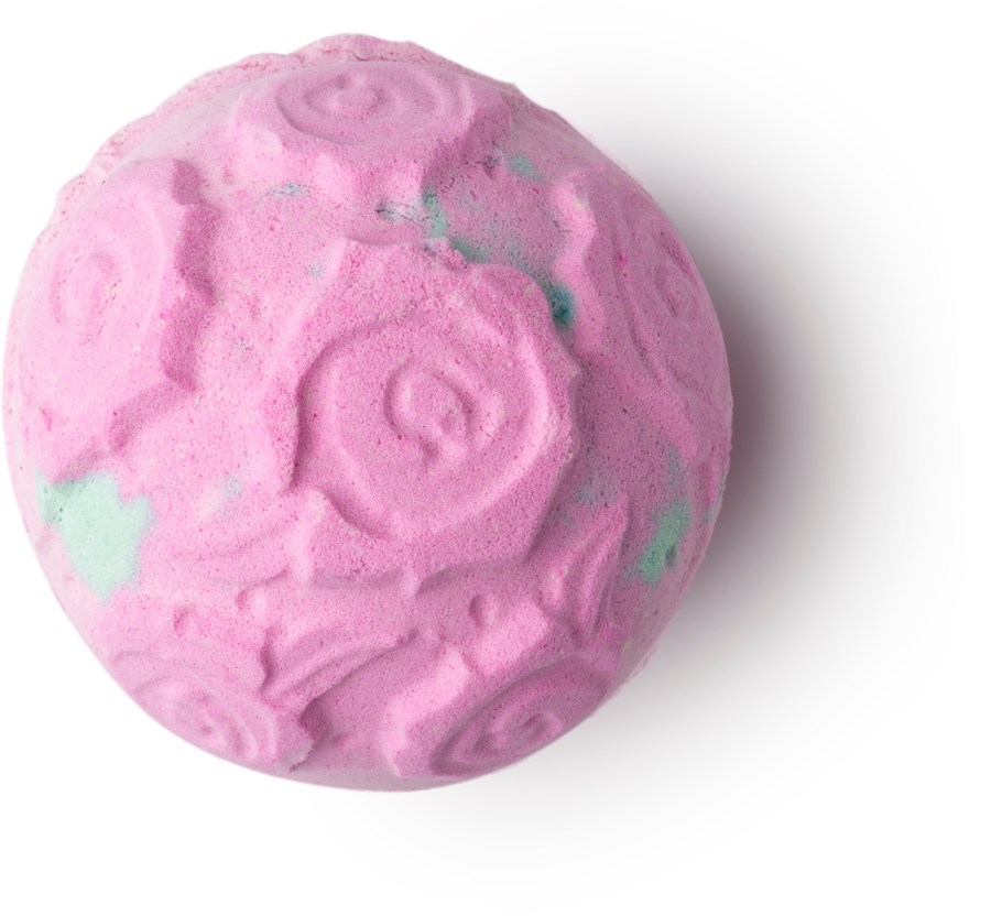 A light pink circular bath bomb with engraved roses all over it, on a white background.