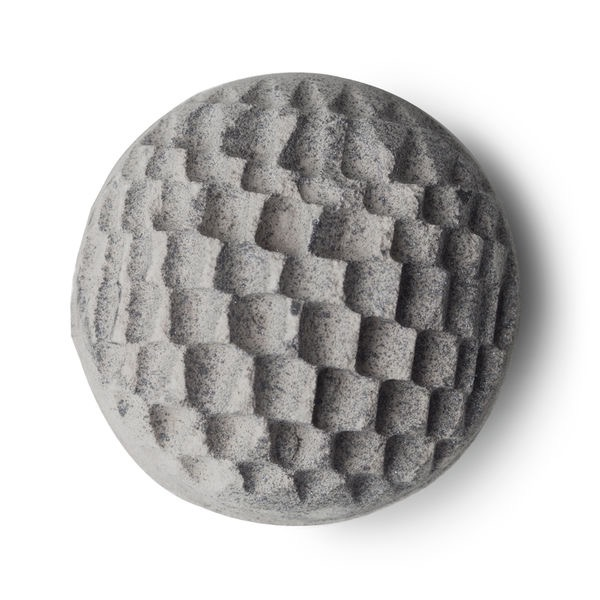 A silver spherical shaped blue tinted bath bomb with an intricate design all over it, on a white background.
