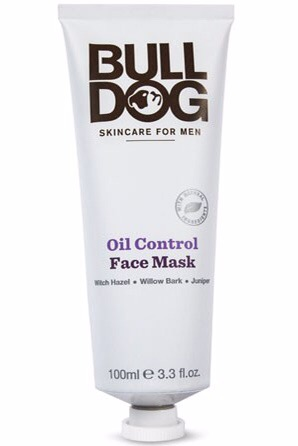 A tall thin conical shaped white bottle with a white thin circular lid and a label that has Bulldog written in large black writing and skincare for men oil control face mask written in smaller black writing on it, on a white background.