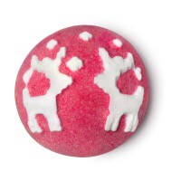 A bright red spherical bath bomb that has two white Reindeers engraved into the top of it, on a white background.