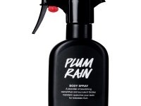 A tall black plastic kitchen spray bottle that has Plum Rain Body Spray written in bold white writing on it, on a white background.