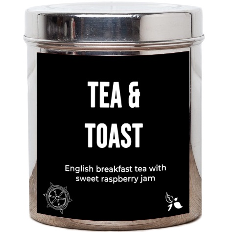 A cylindrical silver tub that has a black sticker with tea & toast written in white writing, english breakfast tea with sweet raspberry jam written in white writing and a picture of some leaves on it, on a white background.