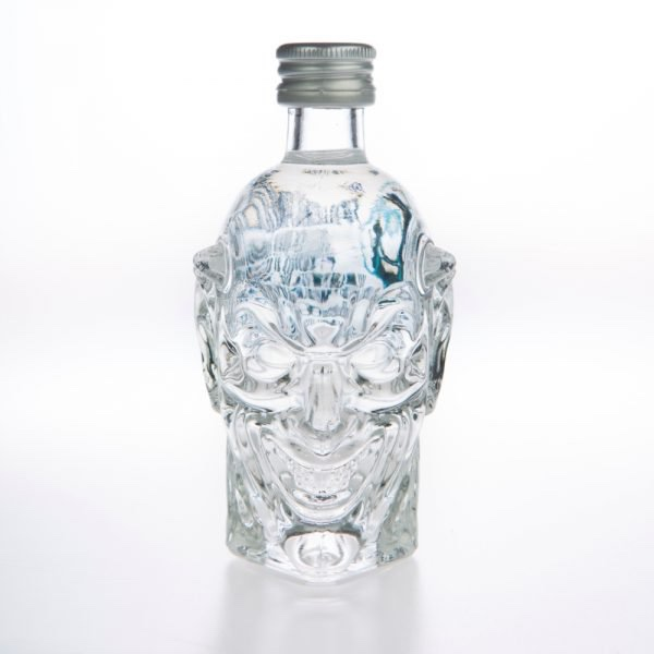 A short Devil's Head shaped clear Glass Bottle with a silver lid full of some clear liquid, on a white background.