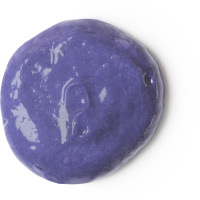 A circular puddle of dark purple conditioner, on a white background.