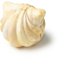 A large light brown shell shaped bath bomb that has some gold lustre embedded on top of it, on a white background.