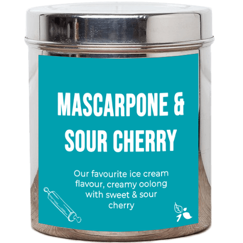 A short cylindrical silver metal tub with a light blue label that has bird & blend tea company Mascarpone & Sour Cherry written in bold white writing on it, on a white background.