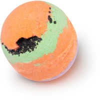 A large spherical shaped green, purple and orange striped bath bomb that has a small crack on the front of it with some pieces of sea salt coming out of it, on a white background.