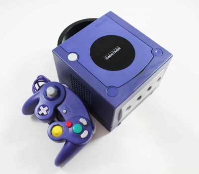 This is an image of a GameCube and its controller