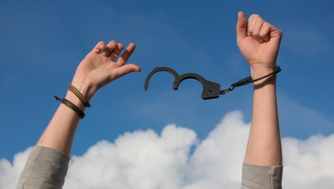Detoxing hands breaking free from handcuffs
