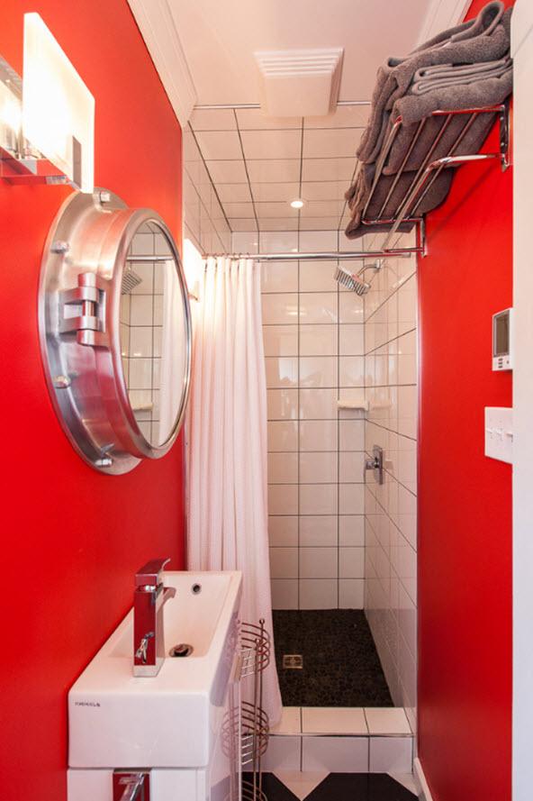 baie cu chiuveta mica si pereti portocalii