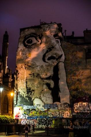 Fresque sur une façade d'immeuble près du centre Pompidou. ©Lumi Poullaouec