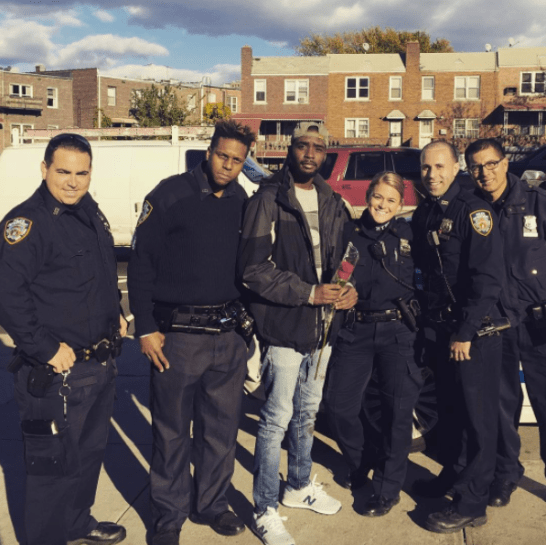 """Mordancy Caption: Special thanks to the good officers of the NYPD who dedicate their lives to make ours better! I learned a lot from our encounters...I'm happy to say that this was a positive one! It's funny...the young girl I defended gave me this rose and the sergeant said that I was """"the rose that grew from concrete."""" ? Funny how life works...."""